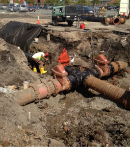 Crews replace a water main in Camden's downtown waterfront area, as  part of Coopers Ferry Partnership's work to create the infrastructure necessary to spur economic development in Camden.